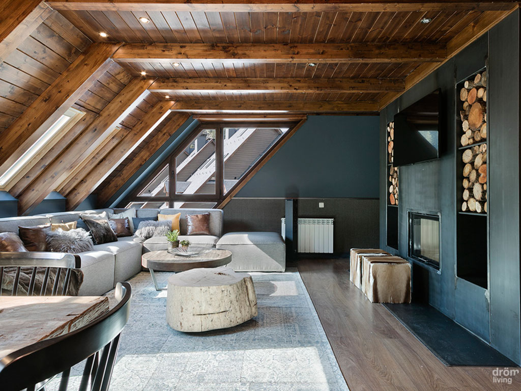 salon habitacion baquiera mesa de madera estilo rustico sofas y butacas belta frajumar